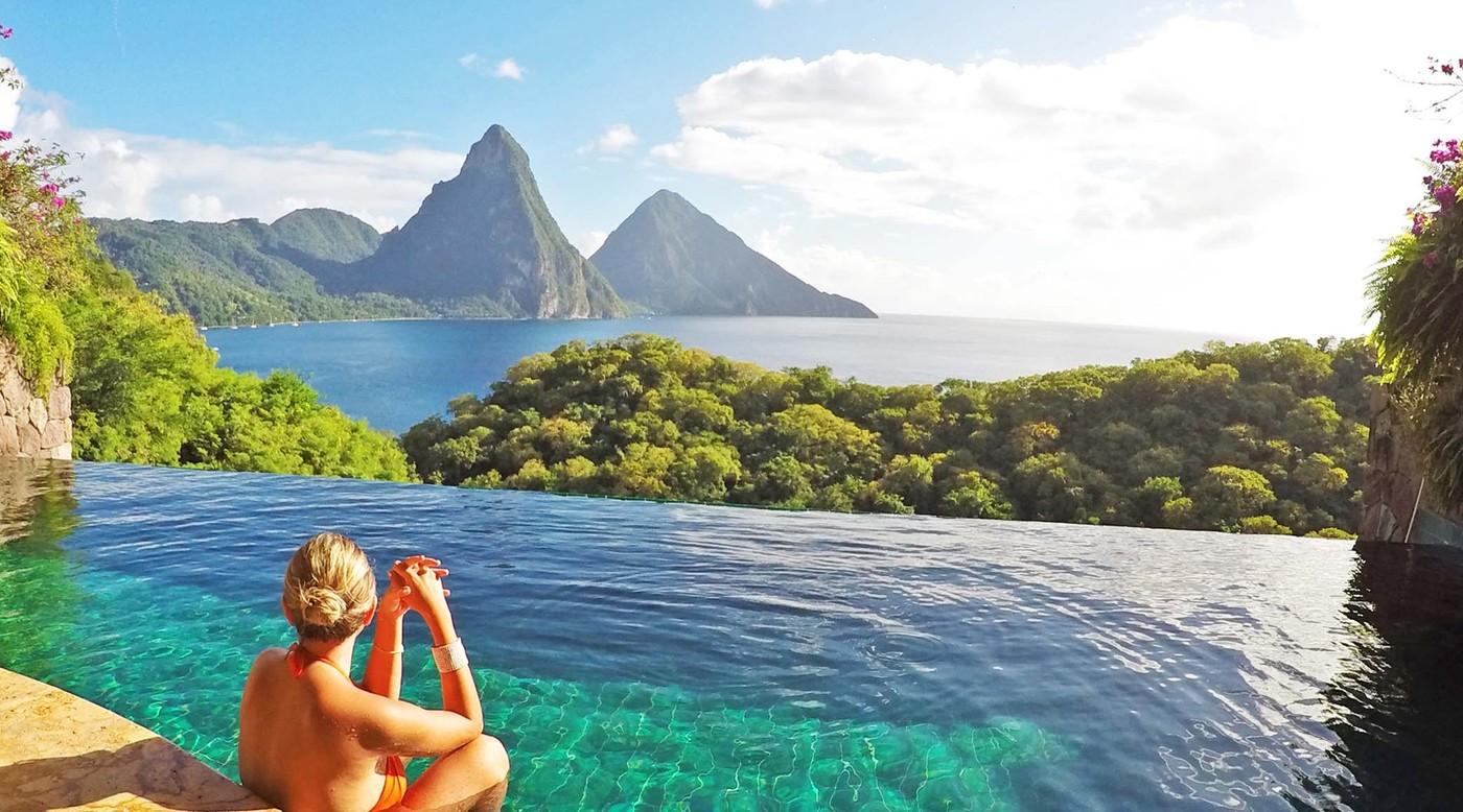 woman in bikini in sea overlooking Jade Mountain