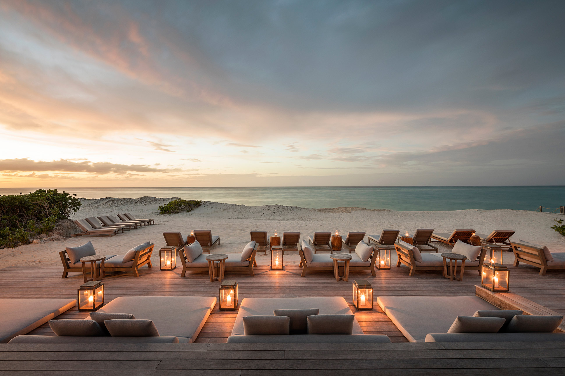 Turks and Caicos retreat sunset with loungers and beach views