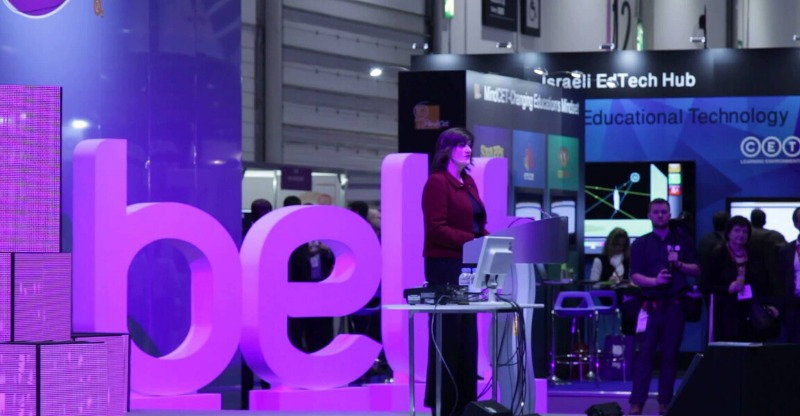 bett conference speaker on stage with purple bett letters behind