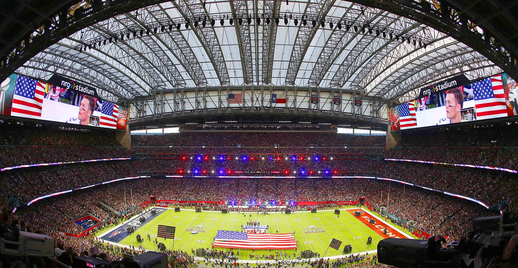 super bowl stadium with flag and crowds