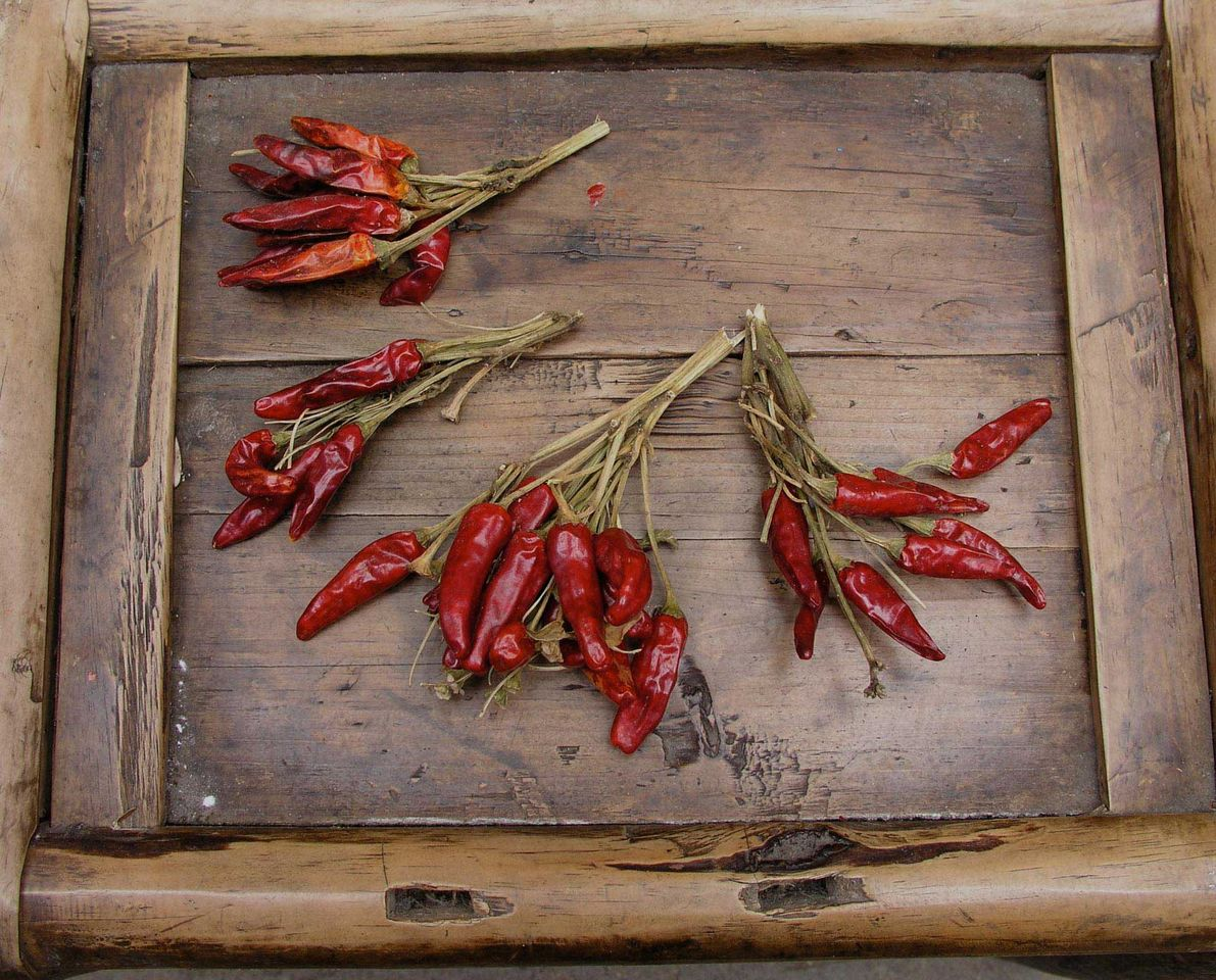 Gastronomic tour china chilli peppers on wooden crate