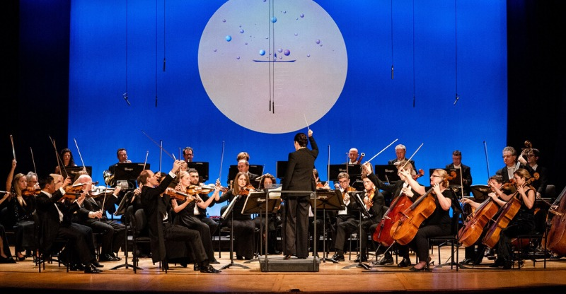 orchestra and conductor on stage at cartagena music festival