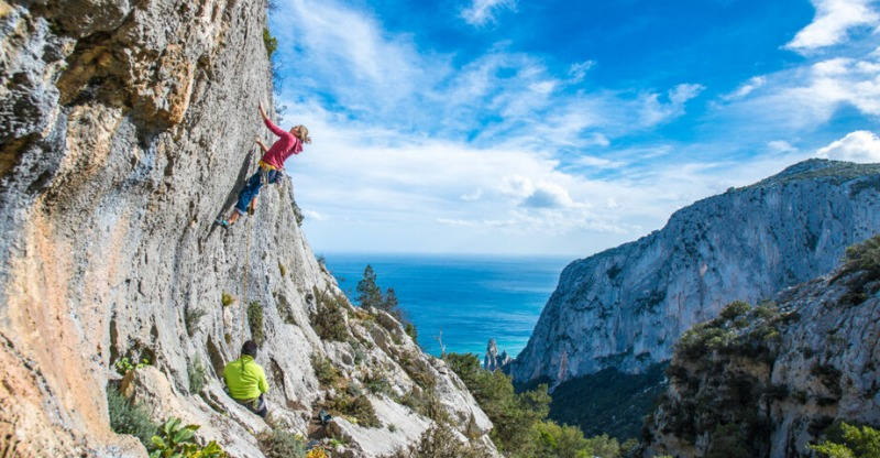 Rock climbing under the blue sky in Sardinia