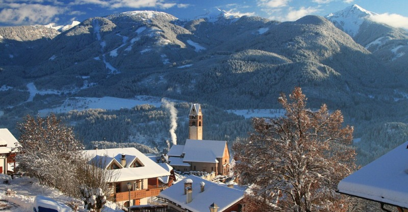 Scenic backdrop of the Dolomite Mountains over Fiemme