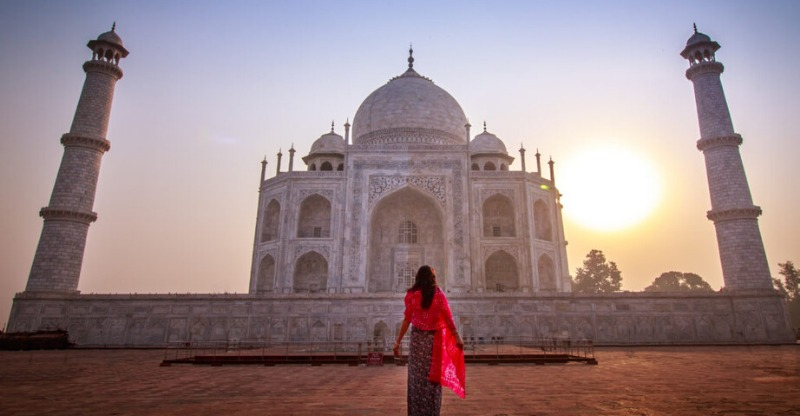 Standing in front of the iconic Taj Mahal