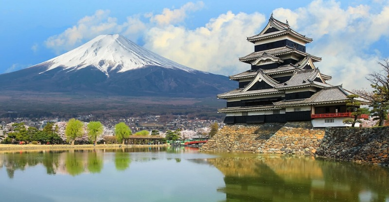 Matsumoto castle in japan overlooking the mountain