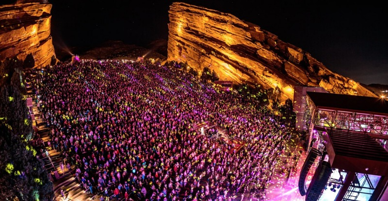 Audience lit up by the lights under the red rocks of Colorado
