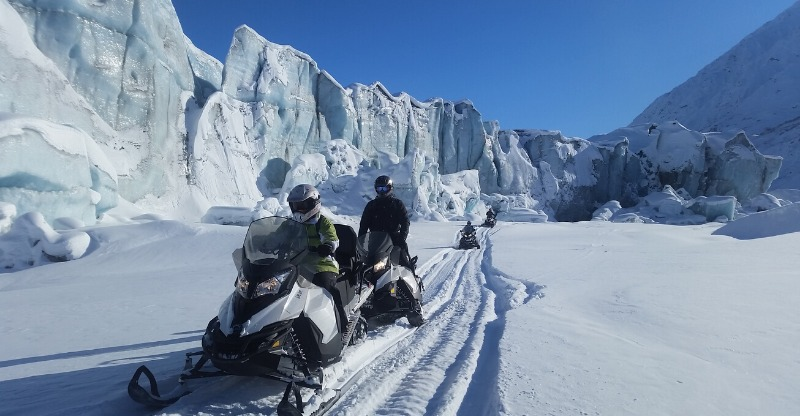 Two Snowmobiles in the outbacks of snowy Alaska