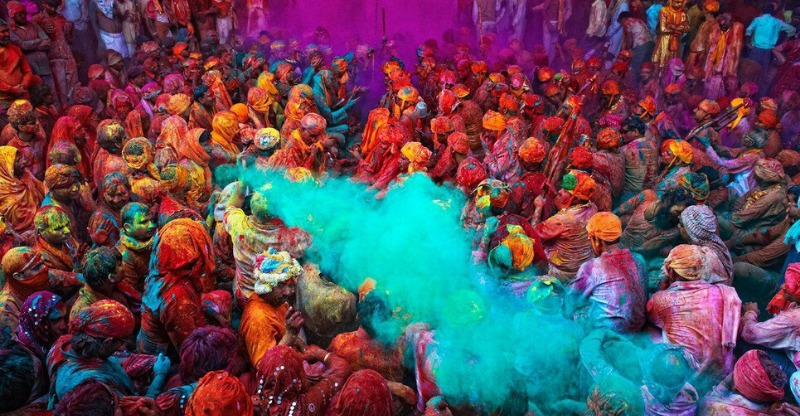 Crowds bathed in vibrant colours at India's Holi Festival
