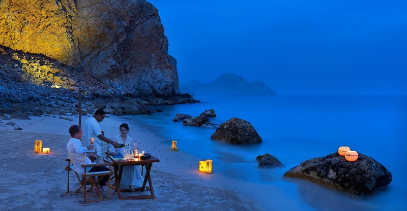 Dining on the beach at the Six Senses Zighy Bay
