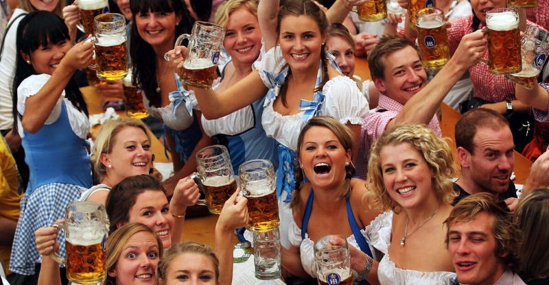 Group of friends enjoying beers at the Oktoberfest