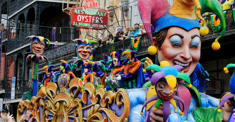 New Orleans Mardi Gras float moving through the streets