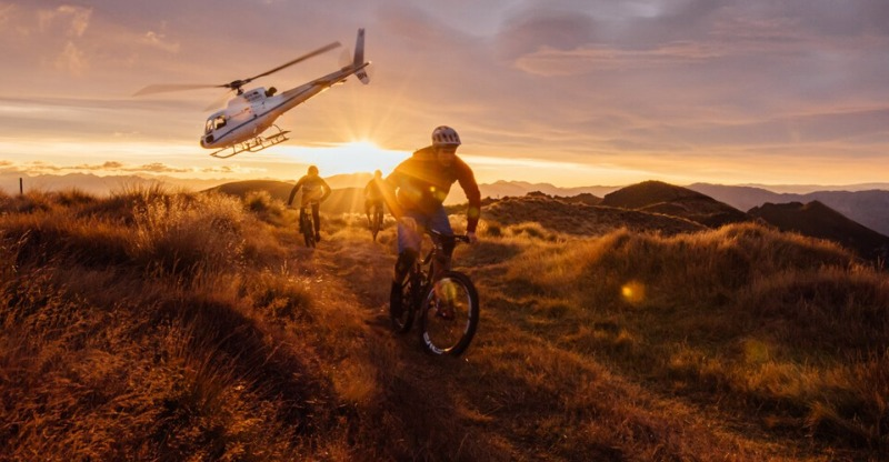 Helicopter and three cyclists in New Zealand