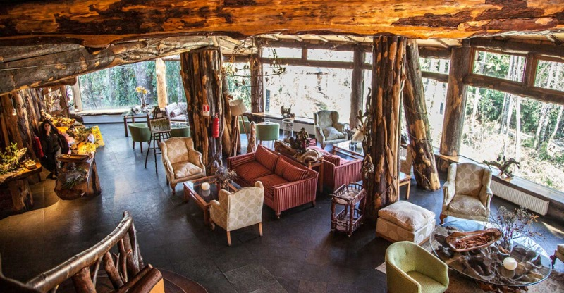 Cosy wooden seating area at the Magic Mountain Lodge