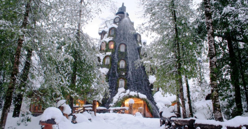 The snow covered Magic Mountain Lodge in Chile