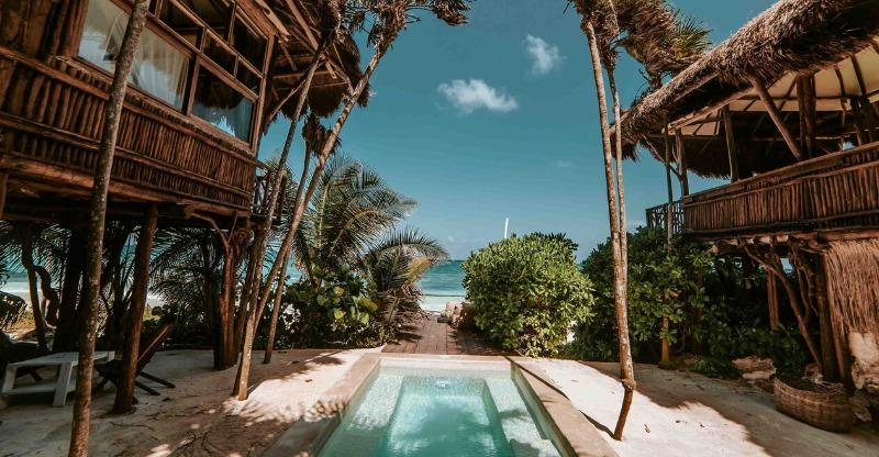 Swimming pool between the beach huts at the Papaya Playa Project