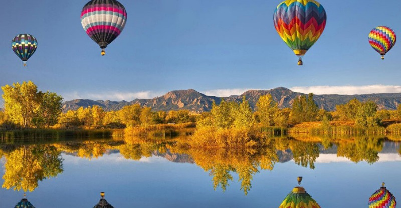 Rocky Mountain Hot Air Balloon Ride reflecting in the water