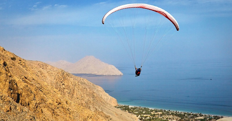paragliding to luxury hotel over desert and ocean in Oman
