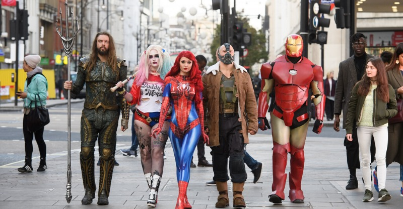 Superheroes walking down the street to the MCM Comic Con, London