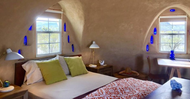 Bright bedroom at the Off Grid Adobe Desert Dome