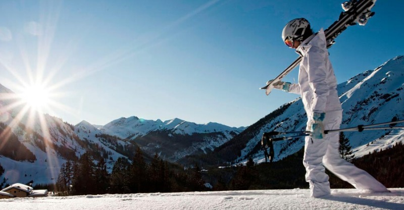 Skier walking through the powdered snow in Tyrol Austria