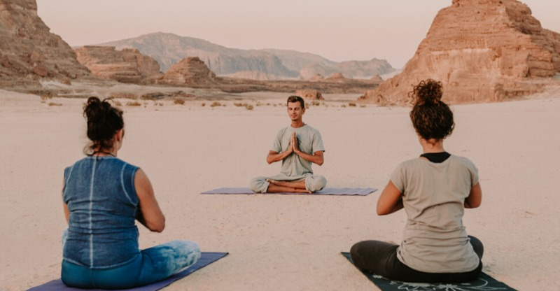 Yoga practice in desert wilderness of Dahab