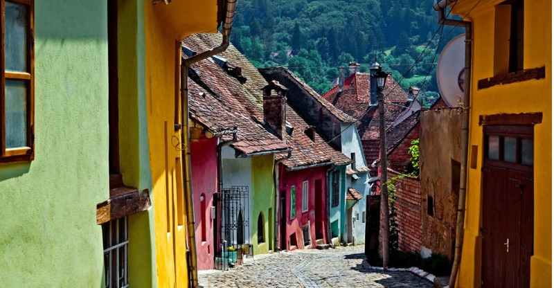 Beautiful coloured houses through Romanian cobbled streets