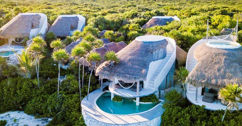 Stunning beach huts at the Papaya Playa Project