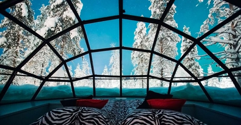 The glass domed bedroom looking out at the snowy expanse in Kakslatuttanen