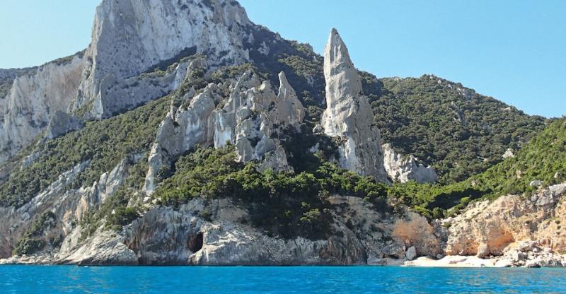 Scenic rock climbing outcrops under the azure blue sea in Sardinia