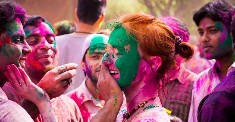 A woman being covered in colour at the Holi Festival