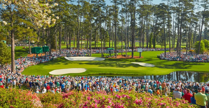 Golfing crowd surrounding the green at The Masters