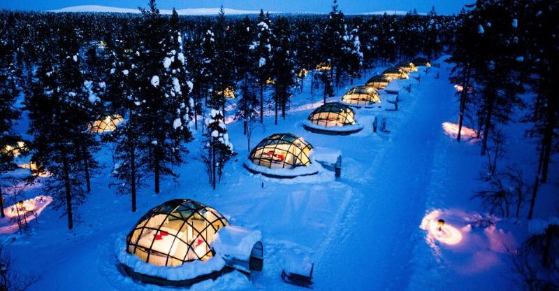 Kakslauttanen glass igloos lit up under the nights sky