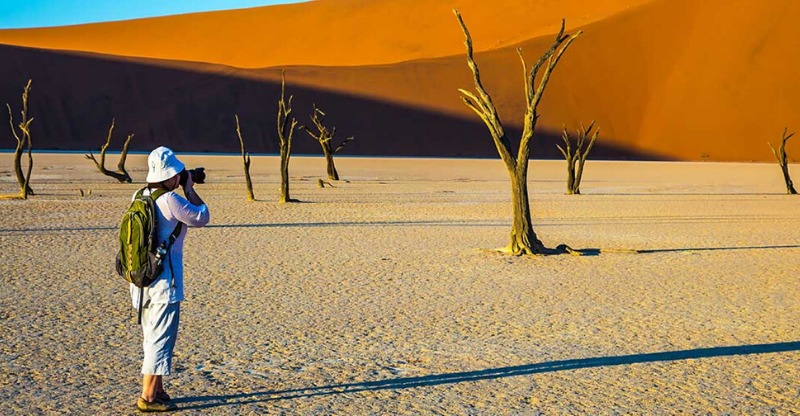 Photographer at the sand dunes on the skeleton coast
