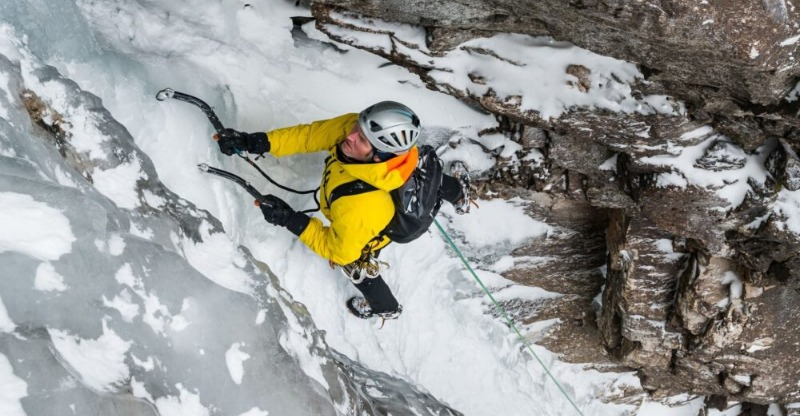 Climber scaling the frozen face in Canada