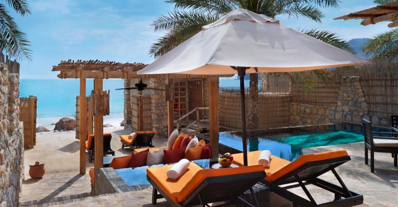 Sun loungers overlooking the beach at the Six Senses Zighy Bay