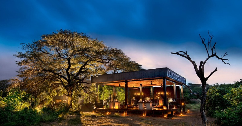 Phinda Rock Lodge outdoor seating area at sunset