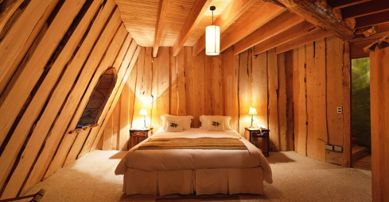 Wooden cabin inspired bedroom at the Magic Mountain Lodge