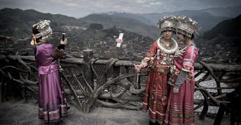 Two women dressed up for a photo on the China Nomad Photo Tour
