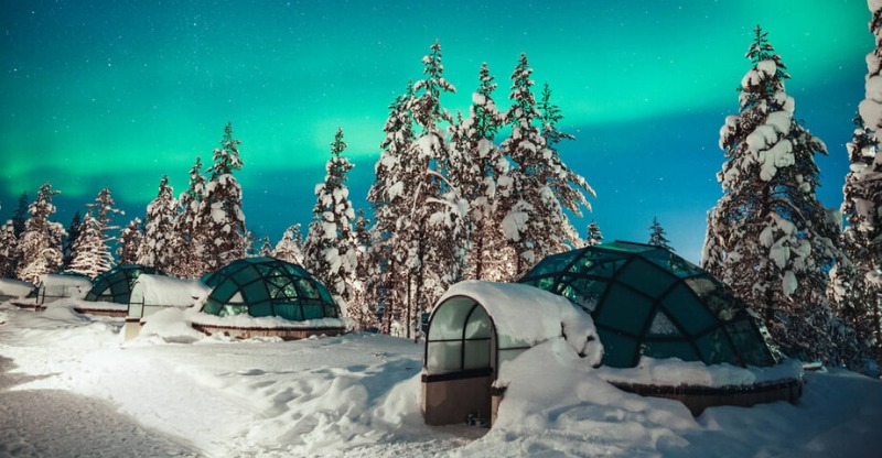 The northern lights from a glass igloo in Kakslatuttanen