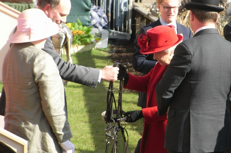 Queen receiving a bridle