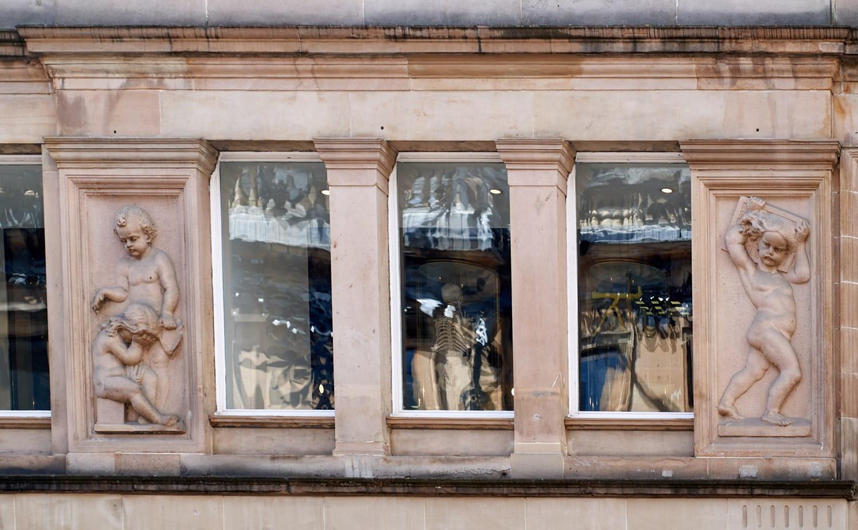 Above the main doorway, left. toshiepix