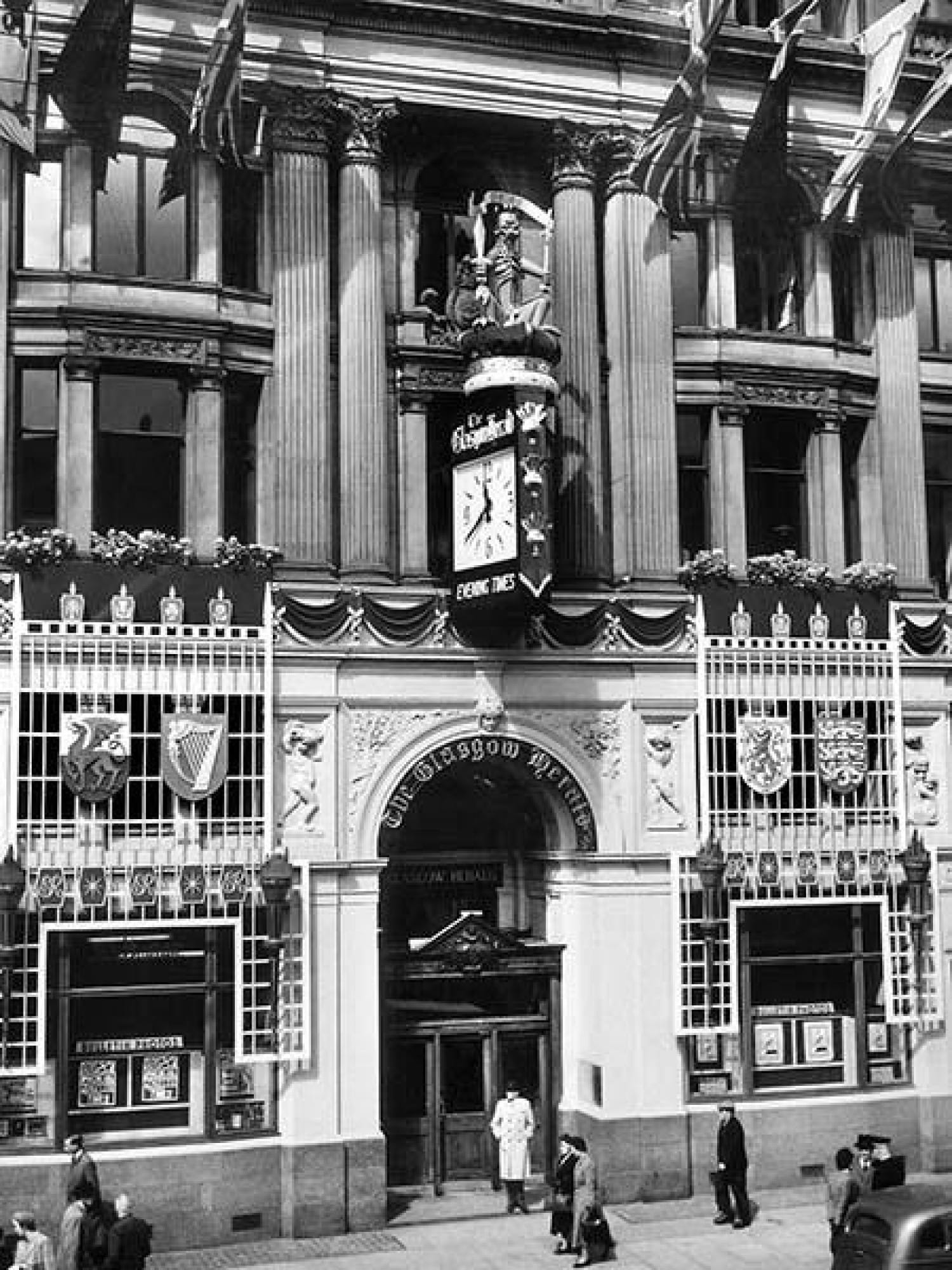 The building, with the old clock, all dressed up for the June 1953 Coronation (Picture: Herald and Times Group)