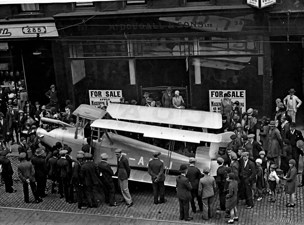 How much is that biplane in the window? (A Mark IV Blackburn Bluebird bi-plane is delivered to Waldorf Aero Auto in Sauchiehall Street (Herald and Times Group))