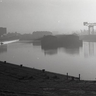 Sitting on the dock of the Clyde (The double basin of the old Queen's Dock)