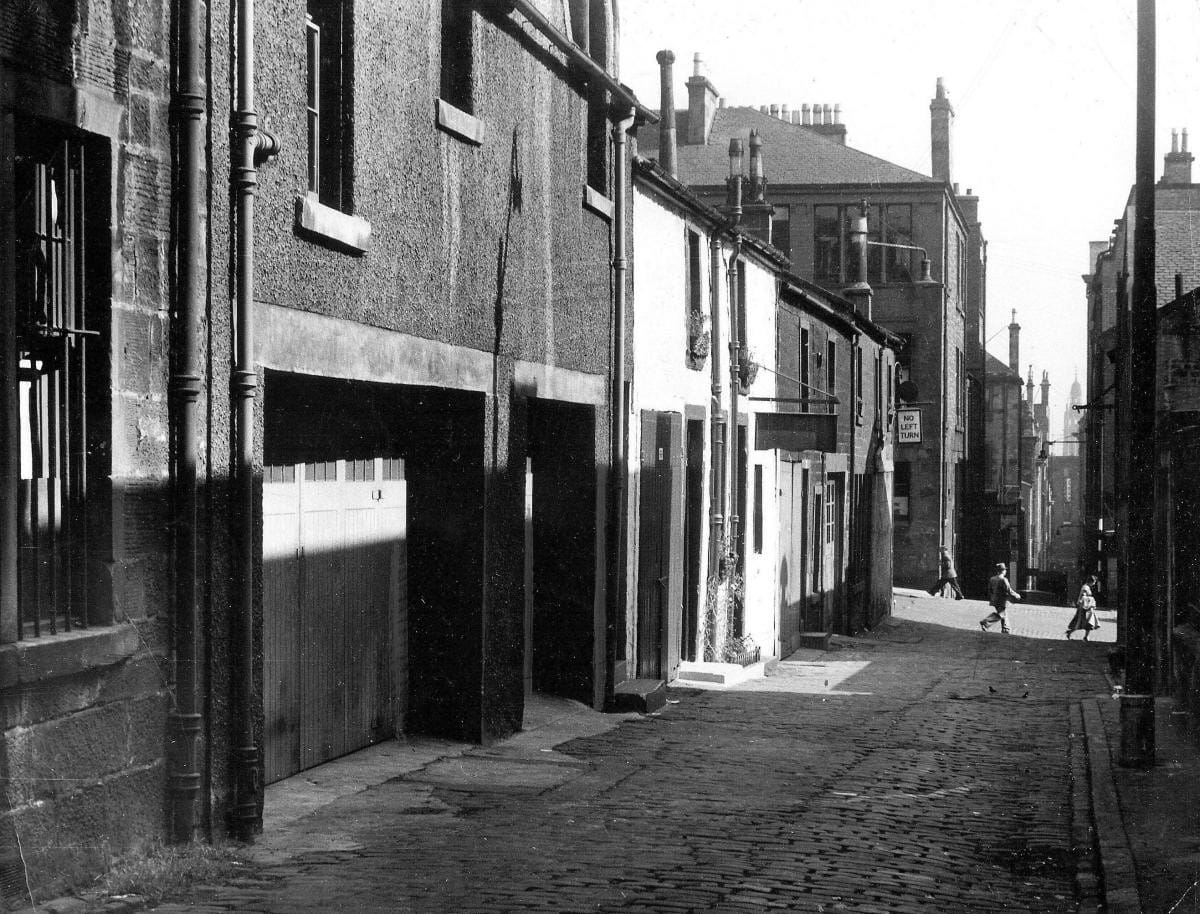 A talon to a mews... (West George Street Lane, looking east, 1953 (Newsquest Media Group))