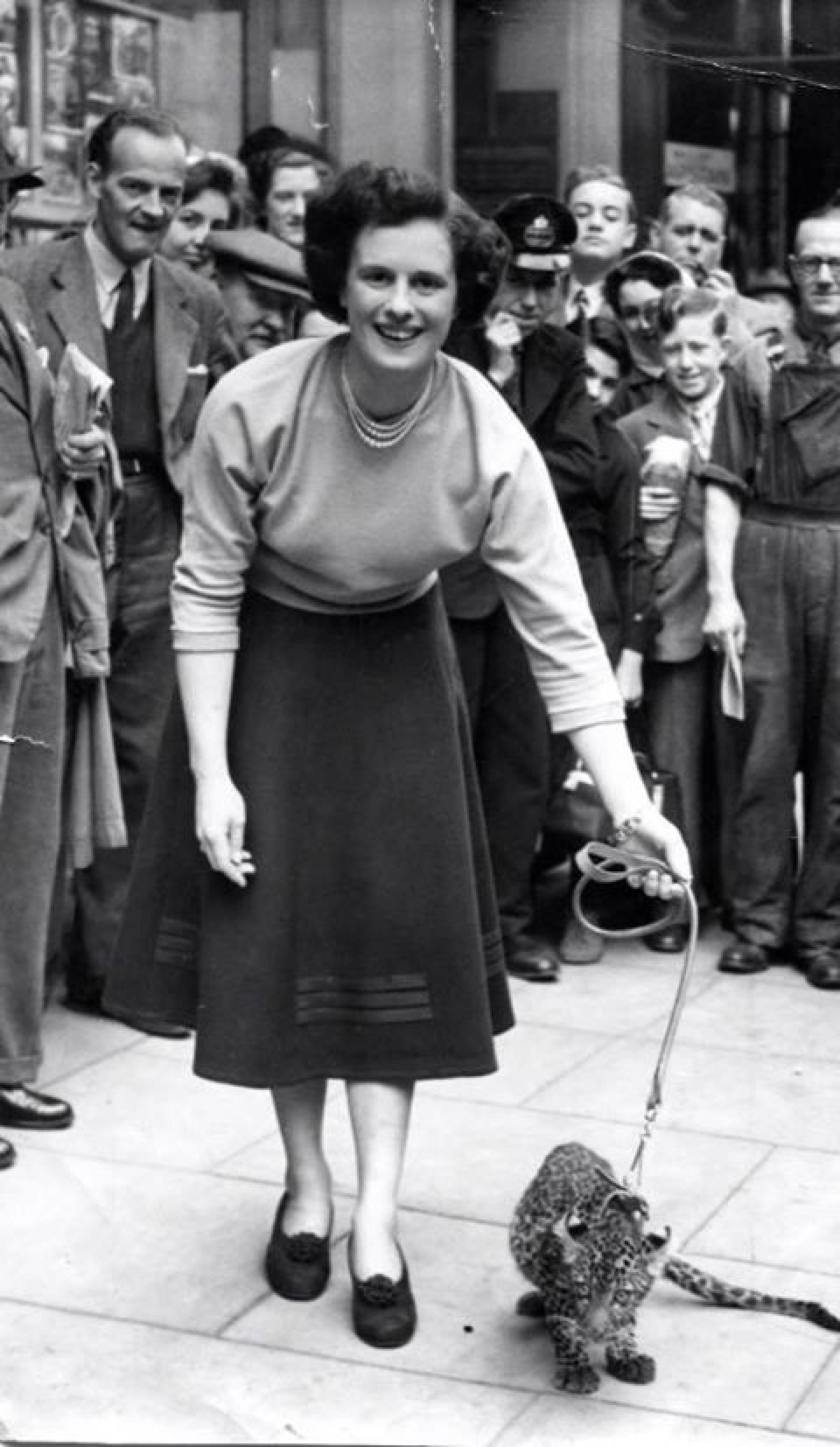 Spotted in Buchanan Street! (Mae Law walks a leopard cub in Buchanan Street, in 1952/3)