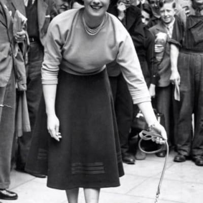 Spotted in Buchanan Street! (Mae Law walks a leopard cub in Buchanan Street, in 1952/3)