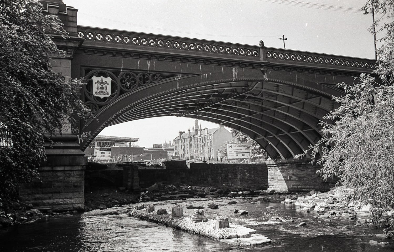 Another view below Kelvinbridge, with the supports of the old, low level bridge still in place