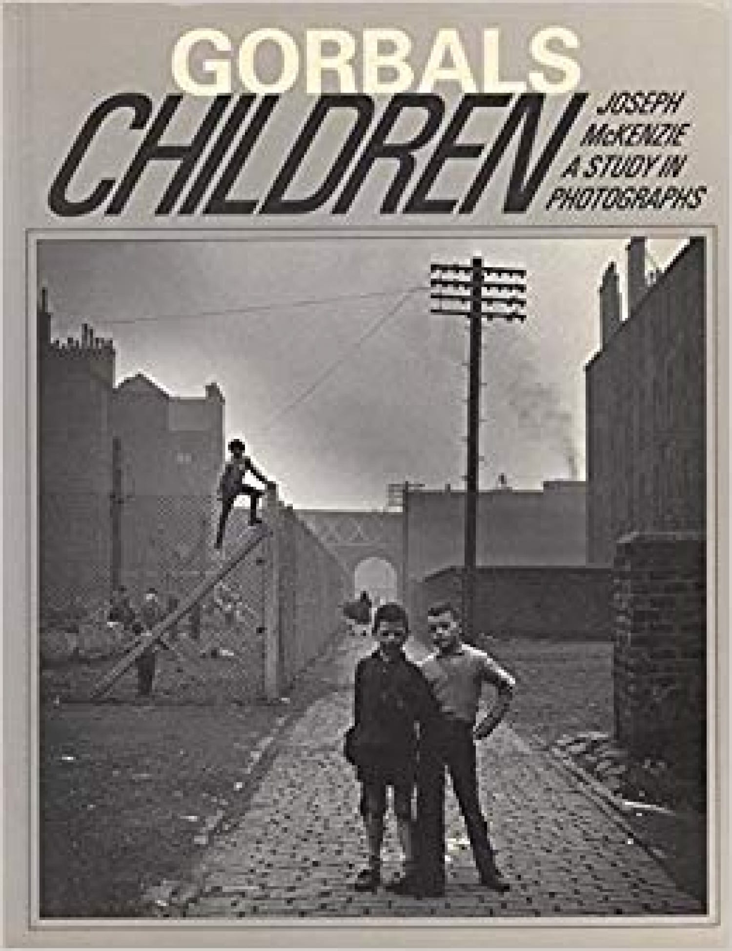 McKenzie's study of childhood life in the Gorbals. Think that's the old 'Venny' adventure playground, opened and run by then school teacher Matt McGiinn, in the background